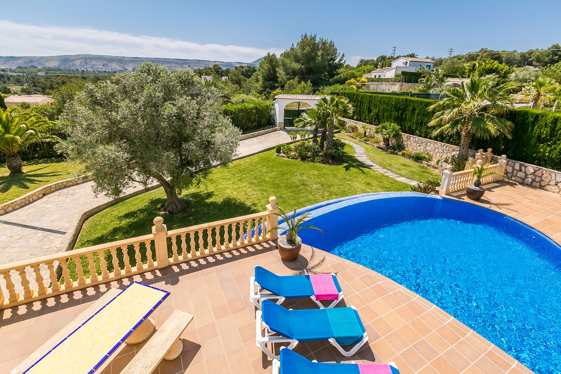 Javea rentals sun terrace with pool and mountain view.